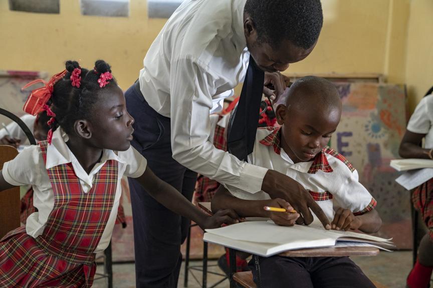 haitian teacher caring